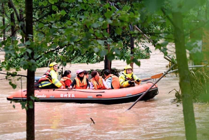 Rescuers transfer stranded villagers in Longtou.