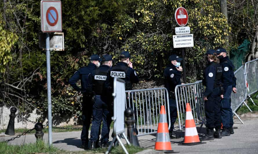 Police officers cordon off the area near the house of the Tapies in Combs-la-Ville.