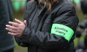 A rider wears an armband during a motorcycle gathering in honour of Harry Dunn.