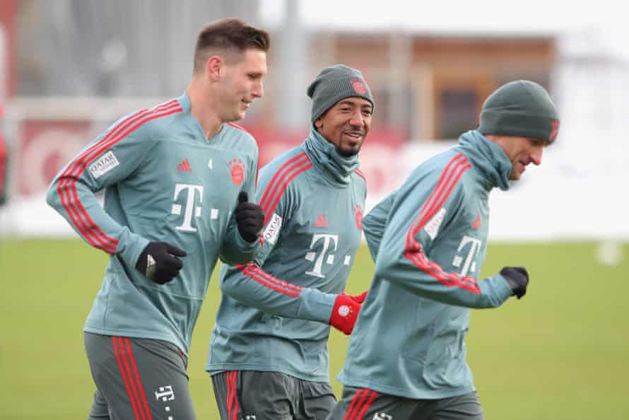 Jerome Boateng (centre) warms up for the second half of the season