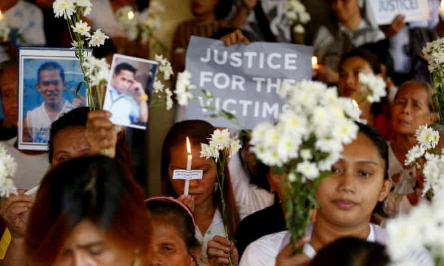 Relatives of victims in President Rodrigo Duterte's so-called war on drugs hold a memorial for their loved ones in Manila