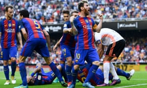 Lionel Messi celebrates his winning penalty as Neymar and Luis Suárez hit the deck