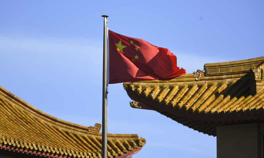 A Chinese national flag flies at the Chinese embassy in Canberra, 30 November 2020.