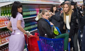 Trolleyed … Rihanna pushes model Cara Delevingne at the Chanel autumn-winter 2015 show in Paris.
