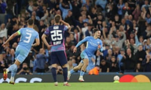 Jack Grealish of Manchester City celebrates after scoring their side's fourth goal.