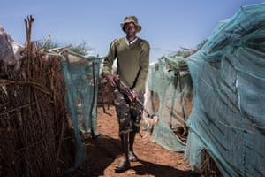 A Kenya Police Reservist poses with his rifle at an IDP camp near the town of Loruk in Baringo County, Kenya