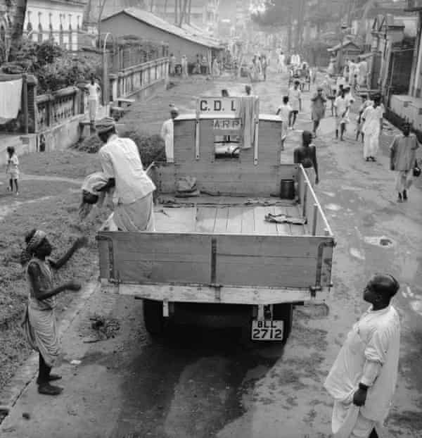 Corpse removal trucks in Calcutta during the famine of 1943.