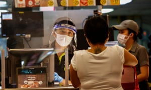 A worker attends to a customer at a fast food restaurant in Quezon City, Metro Manila, Philippines.