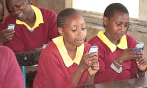 Children use their phones to learn in classroom in Africa