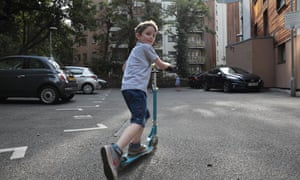 Children without access to a communal play area in Greenwich, south London, play in a car park instead.