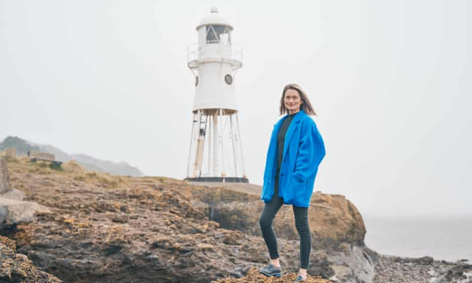 Emma Stonex standing on rocks in front of Black Nore Lighthouse in Portishead.