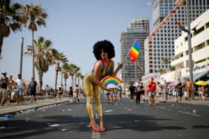 A participant poses during the gay pride parade in Tel Aviv.
