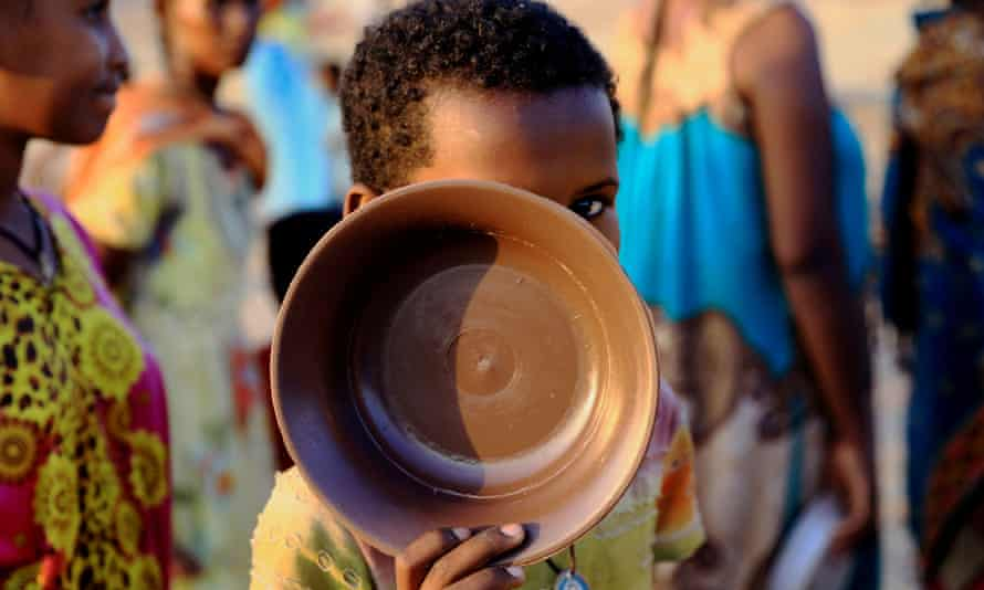 An Ethiopian child stands in the row for food in the Um Rakuba camp, on the border between Sudan and Ethiopia in Al-Qadarif State, Sudan