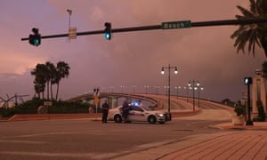 Police prevent access to the barrier island at Daytona Beach as Dorian approaches.