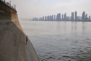 A man prepares to jump into the Yangtze river in Wuhan