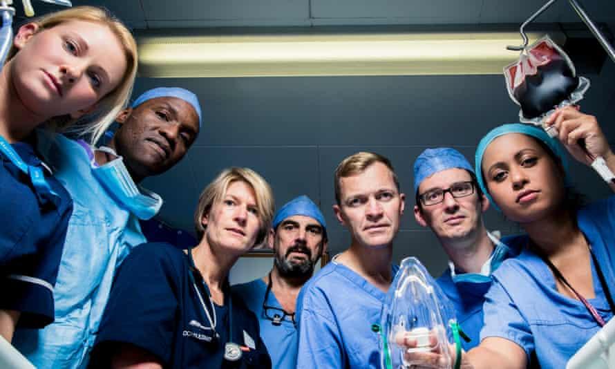 Under pressure … vascular surgeon Richard Gibbs (centre) and team at St Mary's hospital.