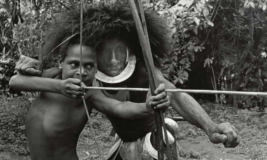 Kaleku being taught to shoot by his grandfather, Dai, in Chimbu Province, Papua New Guinea, taken by Axel Poignant in 1969.