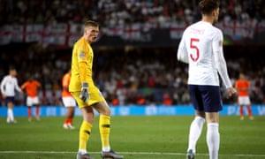 John Stones gets instructions from the England goalkeeper Jordan Pickford.