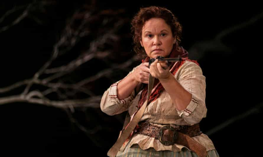 Molly (Leah Purcell) points her rifle at Yadaka, in her radical re-imagining of Henry Lawson's story The Drover's Wife for Belvoir.