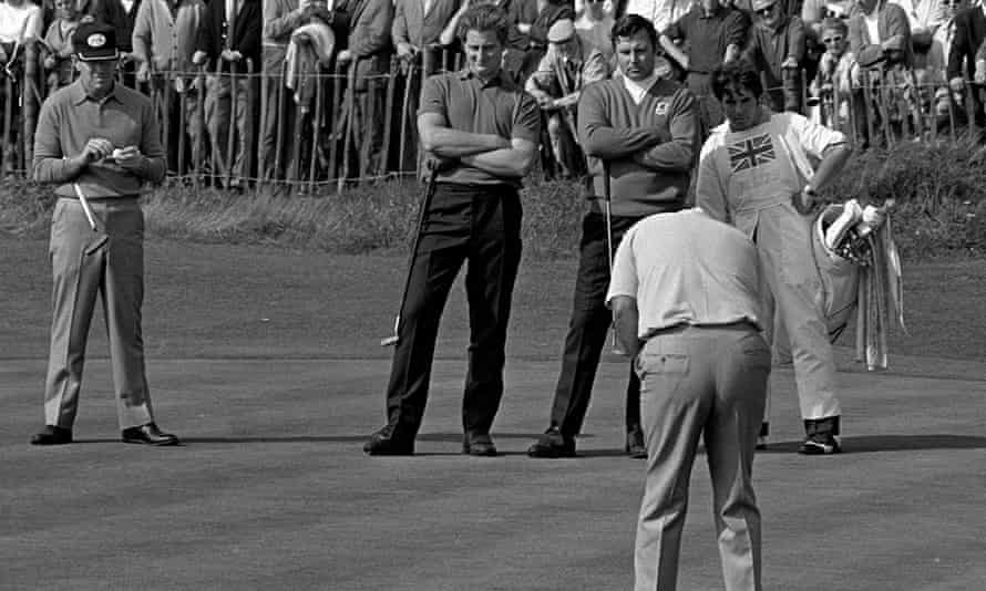 The 1969 Ryder Cup at Birkdale, Lancashire. Brian Barnes, second left, and Peter Alliss, third left, watch as the American golfer Lee Trevino holes a putt to win the match.