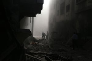 Residents inspect the damage from what activists said was an airstrike by forces loyal to Syria's President Bashar al-Assad on the town of Douma