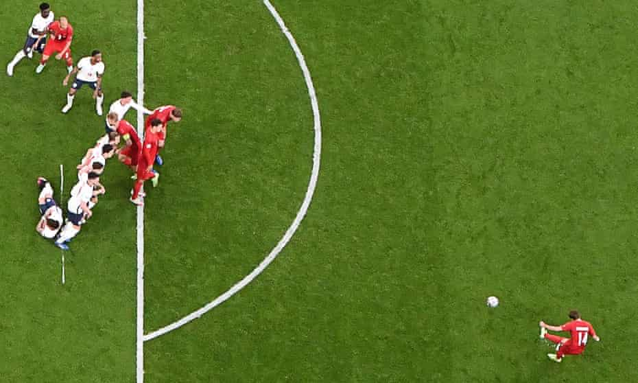 Denmark's forward Mikkel Damsgaard (right) takes a free-kick and scores his team's first goal during the EURO 2020 semi-final football against England.