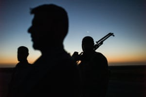 Members of the Asa'ib Ahl Aal-Haq, on the frontlines with Isis, in Diala province to the east of Baghdad, in July 2014.