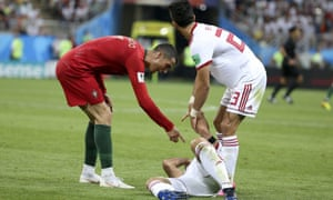 Cristiano Ronaldo accuses the supine Morteza Pouraliganji after the Portugal star elbowed the Iran midfielder