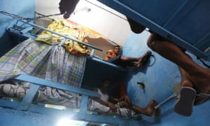 Detainees pose in their cell in the overcrowded Desembargador Raimundo Vidal Pessoa penitentiary in Manaus, Brazil. Inmates have constructed makeshift multi-tier beds in their cells to ease overcrowding.