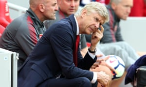 Arsène Wenger contemplates impending defeat against Liverpool at Anfield on Sunday.