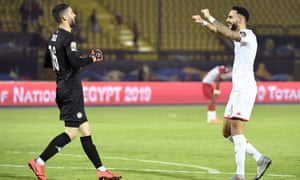 Tunisia's goalkeeper Mouez Hassen (left) and the defender Dylan Bronn celebrate after beating Madagascar 3-0.
