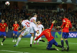 Macedonia's Darko Velkovski scores an own goal to put Spain ahead.