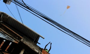 Flying a kite at the top of Turano favela