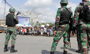 Indonesian soldiers stand guard during a protest in Timika, on 21 August. A