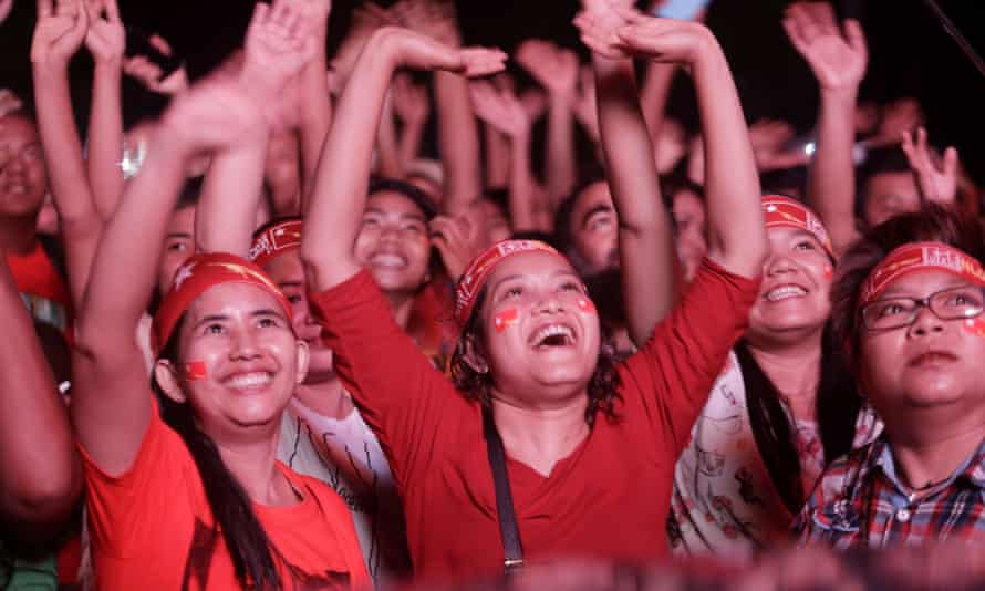 Supporters of Myanmar's opposition National League for Democracy watch the vote counting in Yangon.