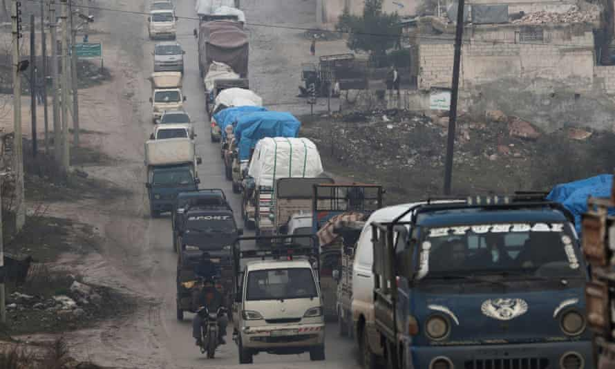 Trucks carrying belongings of displaced Syrians in northern Idlib