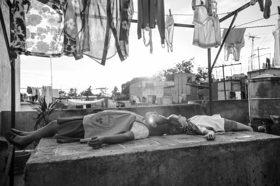 """This image released by Netflix shows a scene from the film """"Roma,"""" by filmmaker Alfonso Cuaron, which will have an exclusive run in theaters before becoming available on Netflix's streaming service. (Netflix via AP)"""