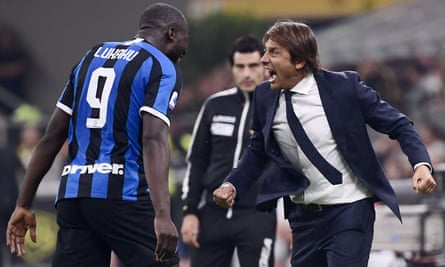 Antonio Conte and Romelu Lukaku enjoy the moment after the Belgian scored the second goal in Inter's 2-0 win over Milan at San Siro.