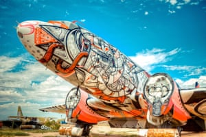 A Douglas DC-3 is one of a number of old warplanes to have been given a makeover by graffiti artists as part of the Boneyard project at the Pima Air and Space Museum.