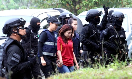 Indonesian woman Siti Aisyah enters court before being charged with murdering Kim Jong-nam at Kuala Lumpur airport.