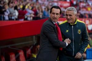 Sevilla's Unai Emery shake hands with Villarreal coach Ruben Uria.