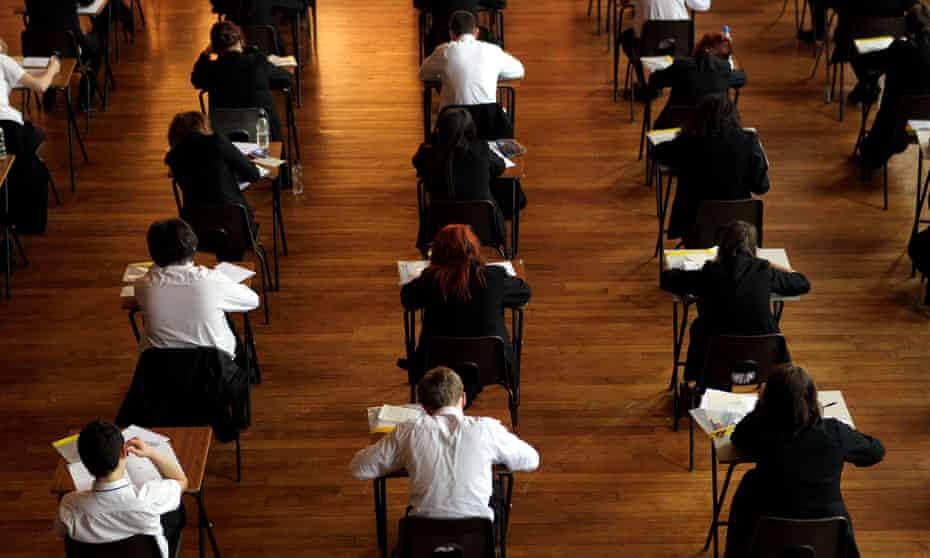 School pupils taking exam