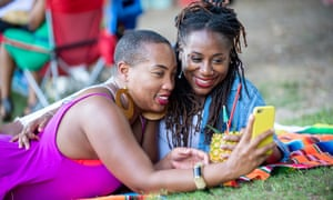 Vernetta Harris and partner Trey Anthony take a selfie as they spend time together at the Pure Heat Community Festival at Piedmont Park in Atlanta, Ga. on 2 Sept. 2018. The festival is the largest event of Atlanta Black Pride weekend. Photograph: Bita Honarvar © 2018 Bita Honarvar