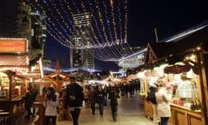 People visiting the Christmas market at Breitscheidplatz square in Berlin.