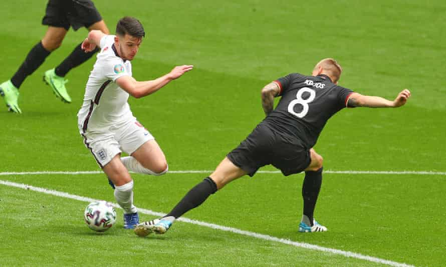 Declan Rice gets the better of Toni Kroos. The West Ham midfielder's frugal use of the ball was crucial to England's success.