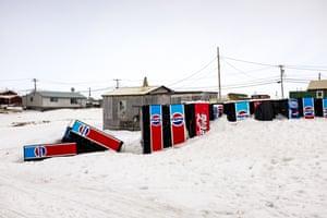"Barrow in Alaska, US. Longitude: -156¡79' 17.15"" Drinks vending machines are buried in the snow"