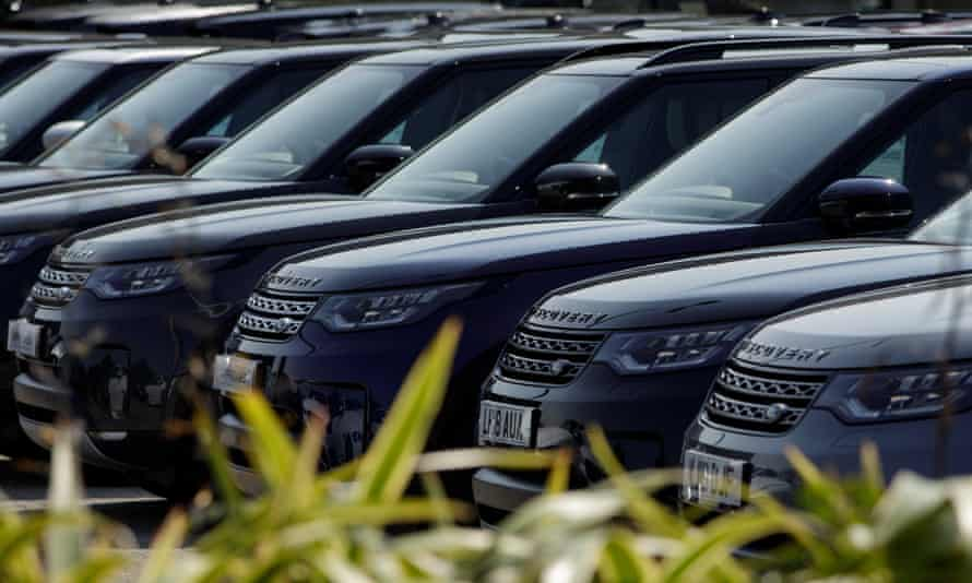 Land Rovers lined up at a Jaguar Land Rover dealership in Reading