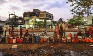 Water commuters wait in line to fill containers at the Vivekananda Chowk water tank in Latur, Maharashtra, India.