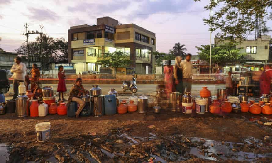 Water commuters wait in line to fill containers at the Vivekananda Chowk water tank in Latur, Maharashtra, India, on Saturday, April 16, 2016