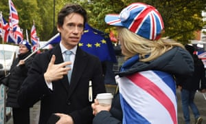Rory Stewart speaks to a demonstrator outside the Houses of Parliament on October 21.